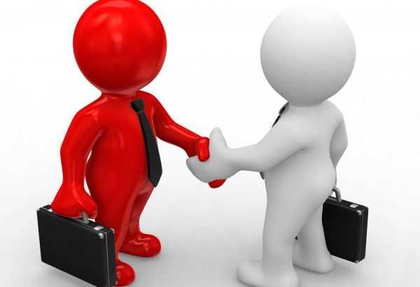 Две фигурки, олицетворяющие людей, пожимают друг другу руки