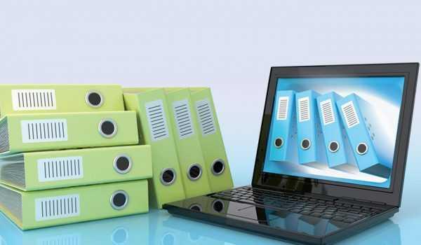 Ноутбук и папки для хранения документов