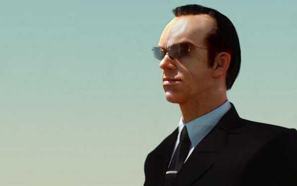 Мужчина в официальной одежде и тёмных очках